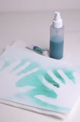 this version of aboriginal handprint art involves watered down tempera paint sprayed over hands.