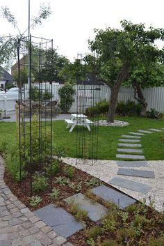 Anna Inreder: Böljande trädgård hos........