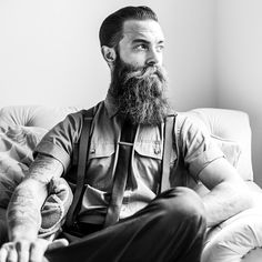 Montgomery Frank Mercado - full thick long dark beard and huge mustache beards bearded man men mens' style dapper suspenders suit tie hairstyle hair cut barber bearding tattoos tattooed so handsome #beardsforever