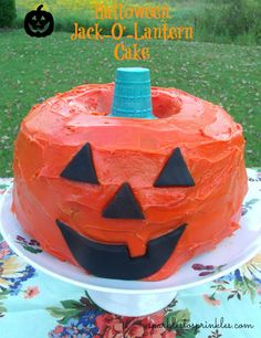 This adorable Halloween Jack-O'-Lantern Cake will be the centerpiece of your Halloween party. It is super easy to make and will bring a smile to everyone's faces.