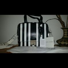 """NWT Marc Jacobs Authentic Domino bag Selling my brand new Marc Jacobs """"The Domino"""" purse!  Completely brand new, never used, still has all the tags and paper wrapped around the shoulder strap.  Comes with authentication card, dustbag and key for the hardware in the front of the bag.  Has been kept in a dustbag on a shelf since i bought it.  This bag is hard to find in general and especially in this wonderful everyday color!   Silver hardware Lamb leather Dustbag 1 functional & removable key…"""