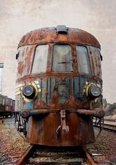 Rusted and with its paint all but peeled away, this train lies abandoned in a train yard in Belgium