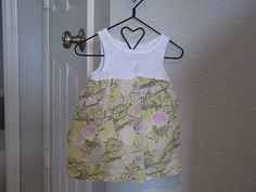 cut onesie or tank top, add fabric from something outgrown = dress. simple and cute!