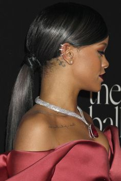 Low Sleek Ponytail With Side Swept Bangs African