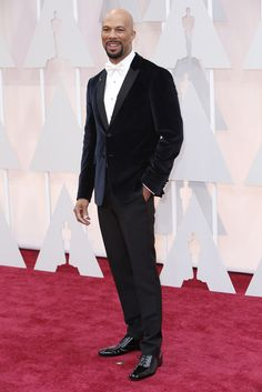 Red Carpet Watch: Oscars 2015 - NYTimes.com   Common  in Prada.