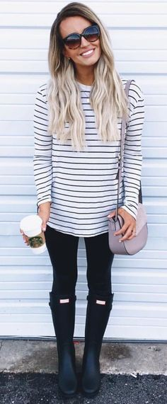 Long sleeved striped blouse with black leggings/jeggings and Hunter boots