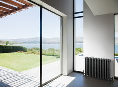 Eco Interiors design and fit high quality German built kitchens in Dublin and surrounding counties, large range of contemporary and tradition styles available. German Kitchen, Cast Iron Radiators, Bathroom Inspiration, Classic Style, Windows, Heating Radiators, Traditional, Contemporary, Interior Design