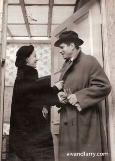 Vivien Leigh & Laurence Olivier photographed in the doorway of their home in London- Durham Cottage. 1950.