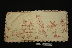 White cotton runner with embroidery in red of a woman and two small children and a man running a windmill. There are ducks in the background. White cotton trim with red border. Photo Buttons, Search People, Online Collections, Museum Collection, Windmill, Ducks, White Cotton, Two By Two, Objects