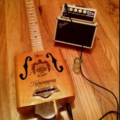 Thad made this cigar box guitar!!!!! He is so talented!!!!!