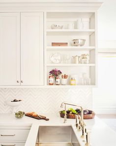 White kitchen, brass fixture