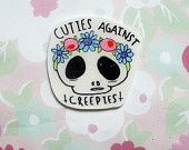cuties against creepies brooch,skull,feminist, feminism,floral crown,90s kid,tumblr, holographic glitter, brooch, punk rock, black and white