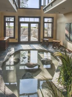 Amazing rustic pool indoor pond bath meditation skylight for Koi pond builders cape town