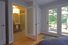 French doors leading to the master bath & new #patio create a light-filled master suite. #frenchdoors