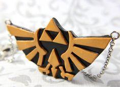 Legend of Zelda Triforce Hyrulian crest necklace by TrenoNights, $27.00