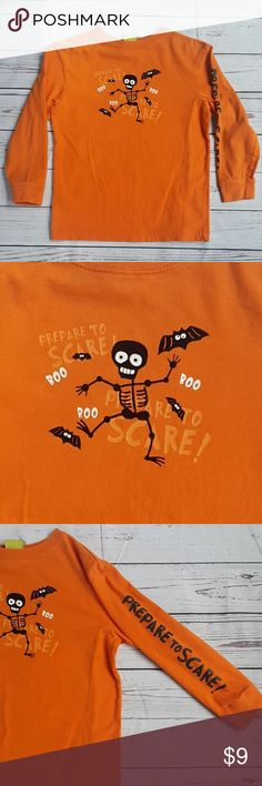 """Prepare to Scare orange Halloween shirt Prepare to Scare long sleeved orange Halloween shirt with """"Prepare to Scare"""" written on the sleeve. Bats, boo and skeletons...oh my! Skeleton is a raised, velvet-feel. Very good pre-owned condition with wash wear, no stains or tears from a smoke & pet-free home.  Size XS (4/5)  Measurements are approximate: armpit to armpit: 16"""" shoulder to hem: 19.5"""" shoulder to cuff: 15""""  B2 Prepare to Scare Shirts & Tops"""