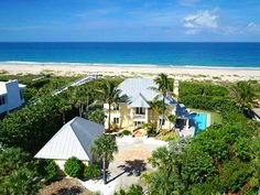 BEACH HOUSE VERO BEACH OCEANFRONT GATED HOME.  Gorgeous tropical oceanfront estate with private gate in the Dunes.  http://www.VeroPremierProperties.com