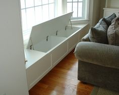 Great Storage solution! By building in a bench underneath your window, you are creating an area to showcase pictures or extra seating; while at the same time creating a great storage solution!