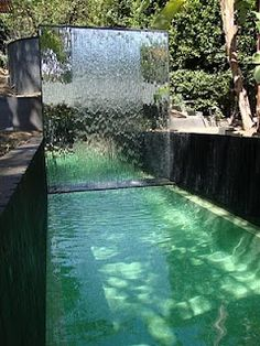 Pool with glass waterfall