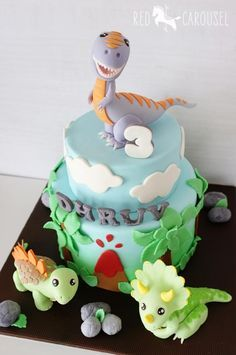 Dinosaurs Cake - For all your cake decorating supplies, please visit craftcompany.co.uk