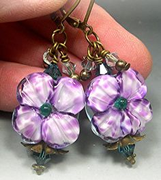 The sweetest blooming beads you will ever find, I've used my own lampwork flowers for these earrings.