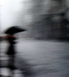 woman with an umbrella blurred view