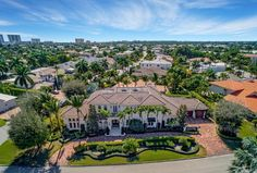 Surrounded by palm trees & blue skies, this Boca Raton property is a beautiful place to relax and call home.