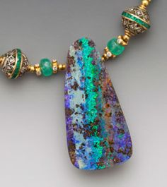 Australian boulder opal on faceted emeralds with fixed stations of emerald…