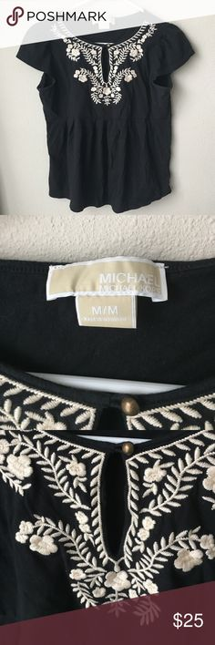 Michael Kors black top w/cream embroidered detail Good condition mild fading. Michael Kors Tops Blouses