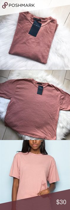 [Brandy Melville] Blush Pink / Salmon Tee Super cute! Soft and comfy. Slightly cropped. But not too cropped. Can fit xs/s/m. Price is high due to Poshmark fees. Bundle to get a bigger discount. Brandy Melville Tops Tees - Short Sleeve