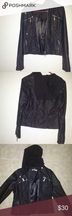 Black Leather Jacket With Hoodie Brand new black faux leather jacket with a removable hoodie. The hoodie is made out of a softer fabric and can be made smaller using the strings. Never been worn. Has pockets with zippers. The inner part of the jacket appears to be satin. Jou Jou Jackets & Coats
