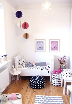 Toddler girl's room with moon inspired prints