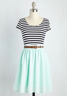 I love everything about this! I love the black and white striped top, and the different colored skirt. LOVE!