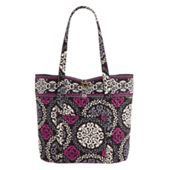 Looked at the other bag I pinned in the store, and I could have fit Cate into it!  This one is a much better size.  I also like the laptop bag mom pinned.  In this color, island blooms, baroque, or la neon rose.