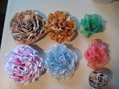 I'm trying ALL the techniques for making flowers. You use the wire ribbon for these lovelies!! For the above flower, I used about 2 1/2 yrds...