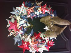 Wreath of Stars for the 4th of July. Used Tim Holtz 3- D star die, foam wreath base and burlap ribbon.