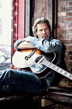 Jeff Bridges with his J-200 and an L.R. Baggs pickup. The same rig I use, except my J-200 is make of Hawaiian Koa.