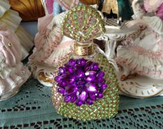 Jeweled perfume bottle in green and purple