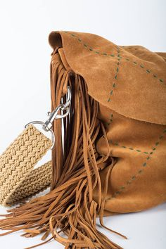 This everyday carry all bag comes in a beautiful soft suede and slouchy camel brown leather, paired with dark green hand embroidery, 16 cm fringed margins, an interior phone pocket and a nicely hand braided adjustable strap, which can easily carry a 15'' laptop and more. Height: 31 cm/ 12.2 inch  Width: 37 cm bottom, 41 cm top/ 14.5 inch bottom/16.2 inch top  Deep: 4 cm/ 1.6 inch  Adjustable strap: 117 cm/ 46 inch This bag is exclusively handcrafted. The leather is ma... Carry All Bag, Everyday Carry, Soft Suede, Leather Craft, Hand Embroidery, Bucket Bag, Camel, Brown Leather, Trending Outfits