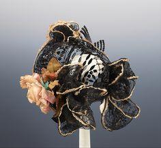 Evening bonnet Designer: Mme. Carlier  Date: ca. 1895 Culture: French Medium: linen, cotton Accession Number: 2009.300.1973