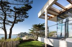 Image 30 of 38 from gallery of House in Crozon / Agence d'architecture Pierre-Yves Le Goaziou. Eco Construction, Terrasse Design, Red Cedar Wood, White Concrete, Made In France, Concrete Floors, Portal, House Plans, House Design