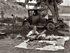 June 1939. Lincoln County, Oklahoma. Camp of migrant workers near Prague. Medium-format negative by Russell Lee for the FSA.