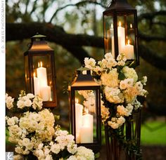 Instead of lining the aisle with flowers, lanterns lit the path to the altar.