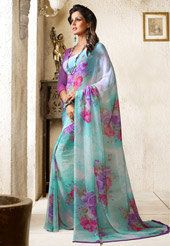Embrace your traditional wear with a hint of contemporary styling with this aqua blue and off white faux georgette floral printed saree. Available with purple faux georgette blouse fabric which can be customized as per your style or pattern; subject to fabric limitation; blouse shown in the image is just for photography purpose. (Slight variation in color is possible.)