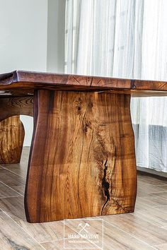 Modern wooden dining table made of solid wood Ash with a live edge. Table in Rustic style for 8 person. Cracks and knots in the wood are filled with transparent epoxy resin. Strong, original woodeb legs are also made of slabs of Ash. Wood is covered with natural oil-wax. Manual