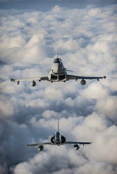 A Royal Air Force Typhoon of 1(F) Squadron (top) and a French Air Force Mirage 2000N practice their formation flying skills during Exercise ...