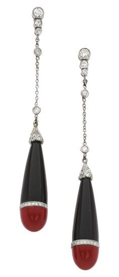 Diamond, Black Onyx, Red Stone, Platinum, White Gold Earrings The earrings feature carved black onyx, enhanced by carved red stone, accented by single and full-cut diamonds weighing a total of approximatley 0.95 carat, set in 14k white gold, completed by posts with friction backs.