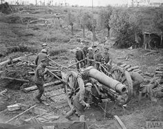 WWI, 27 August 1917; Gunners of the Royal Field Artillery manhandling a 6-inch (BL 6-inch 26 cwt) howitzer, Ypres. ©IWM Q 5945