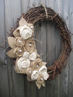Burlap Wreath with Pearls. I found many pictures of burlap flower wreaths similar to this, but I loved this one the very best. So...I just made the flowers in both colors, placed in almost identical places. My finished product looks almost identical to this one. WAY CUTE!
