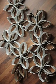 Flowers from toilet paper rolls :) Flatten rolls, cut into .5 or 1 inch rings, hot glue gun ends together & spray paint! - Using this in nursery